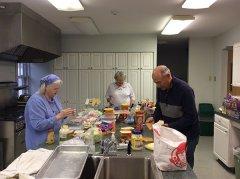 Marlena-Amalfitano,-Leslie-Anne-King,-Bill-Motsko-Making-lunches-for-workers.jpg